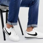 Nike Cortez leather trainers in white with black swoosh